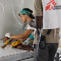 A medic treats baby Fana in the clinic.