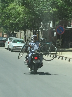 Why cycle when you can bring your bicycle on a motorbike?